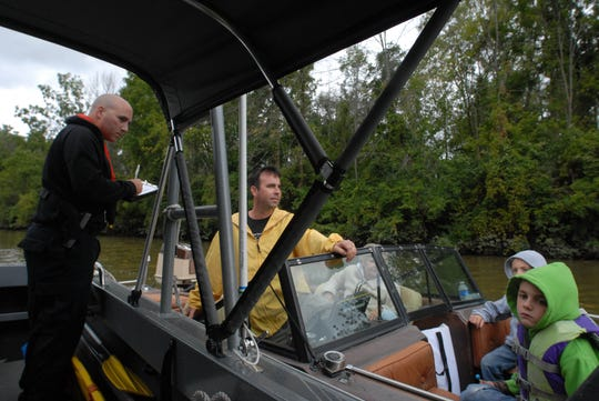 Sgt. Jamison Rose speaks with a boat owner about proper boating gear while on marine patrol on the Sandusky River in 2011. The Sandusky County and Ottawa County sheriff's offices have received over $50,000 in 2019 grants from the Ohio Department of Natural Resources for marine patrol.