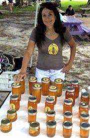 Beekeeper Claudia Silveira of Lee Queen Bee sells her own organic honey at the Alliance for the Arts