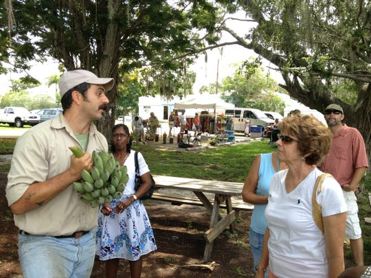 Market Manager Santiago De Choch talks about growing bananas and other tropical fruits in Southwest Florida to a group of more than 80 at the Alliance for the Arts' GreenMarket on Saturday, June 15.