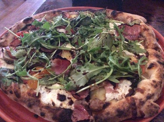 Ciao's pizzas are baked in the restaurant's 900-degree, oak-fired oven.