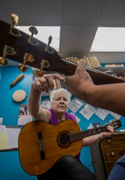 Barbara McCubbin, owner of McCubbin's Music Conservatory in Cape Coral, conducts a guitar lesson Thursday, 3/21/19.
