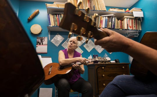 Barbara McCubbin, owner of McCubbin's Music Conservatory in Cape Coral, conducts a guitar lesson.