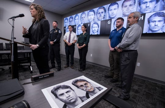 Samantha Steinberg, a forensic artist for the Miami-Dade PD, speaks during a press conference Monday morning at the Fort Myers Police department. Steinberg assisted FMPD in the digital facial re-construction process to develop the portraits visible on the background display.