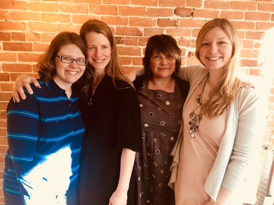 """Katie Dahl, Jenny Bienemann, Jeanne Kuhns and Jess Holland, from left, play their """"Songwriter Friends"""" concert MArch 29 at Third Avenue Playhouse in Sturgeon Bay. The in-the-round concert has the women take turns to perform their songs individually while all are on stage."""