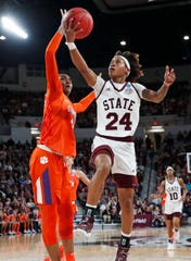 Clemson center Kobi Thornton, left, blocks a layup attempt by Mississippi State guard Jordan Danberry (24) during the second half of a second-round women's college basketball game in the NCAA Tournament in Starkville, Miss., Sunday