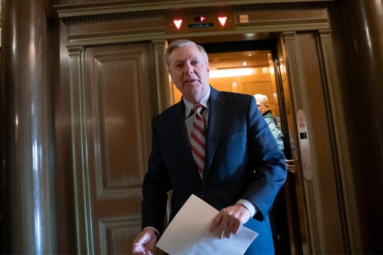 Senate Judiciary Committee Chairman Lindsey Graham, R-S.C., arrives at the Capitol to meet with reporters about the report by special counsel Robert Mueller, in Washington, Monday, March 25, 2019.