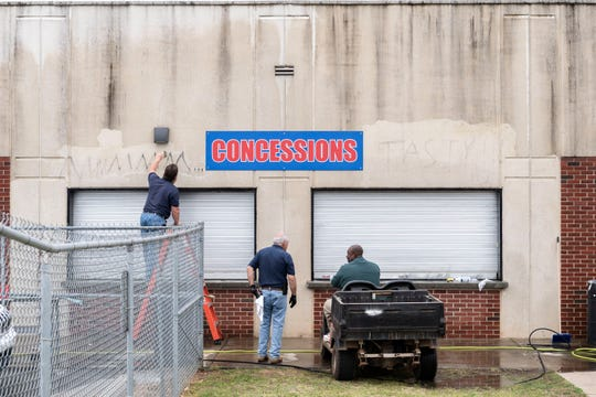 Ricky Bowers, and William Sloan, of the Riverside High School maintenance staff work on removing graffiti on the concessions stand, Mar. 25, 2019.