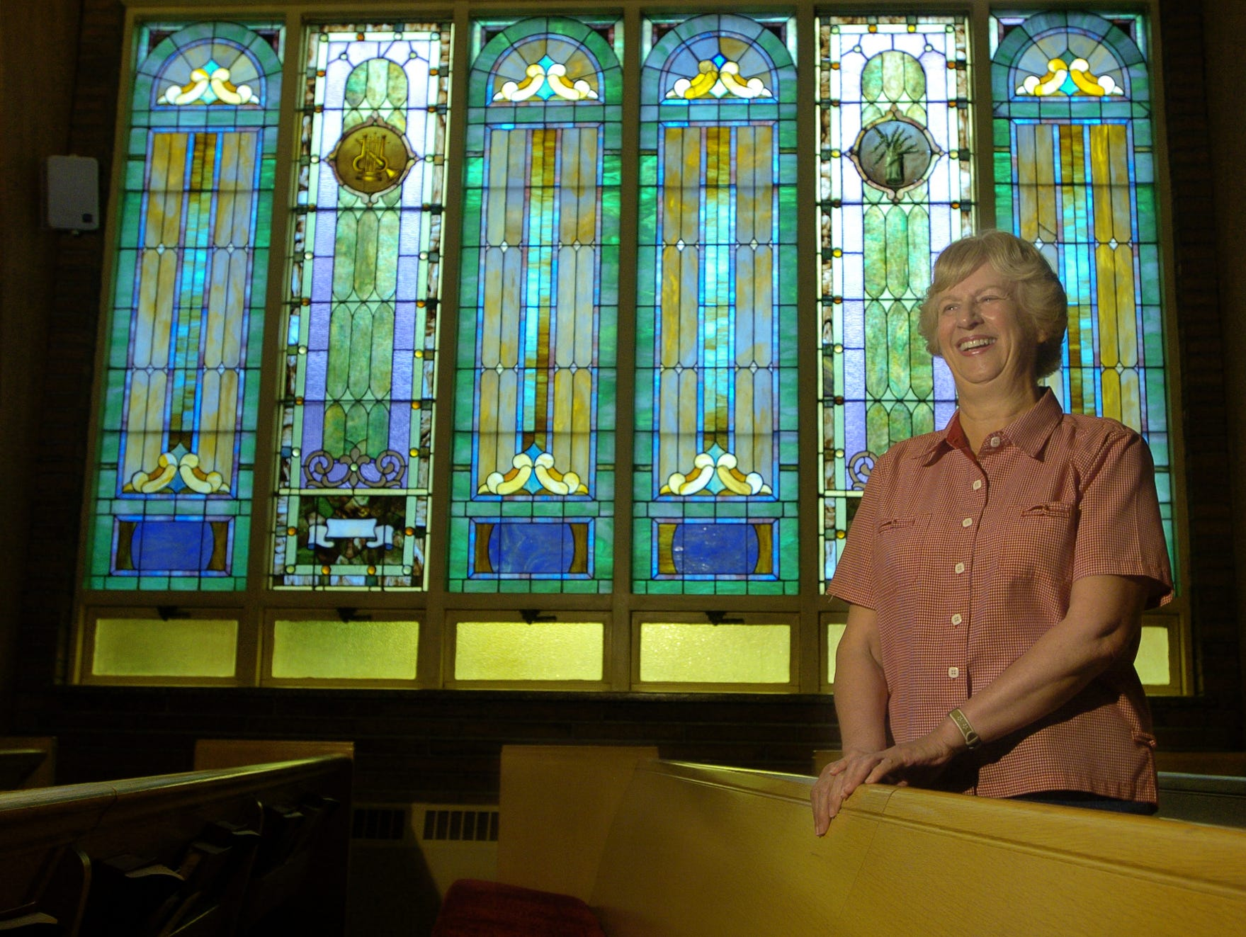 Suzanne Waring stands in the First United Methodist Church in 2006.