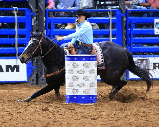 Lisa Lockhart won a national championship in the barrel racing Sunday at the Ram National Circuit Finals in Kissimmee, Fla.