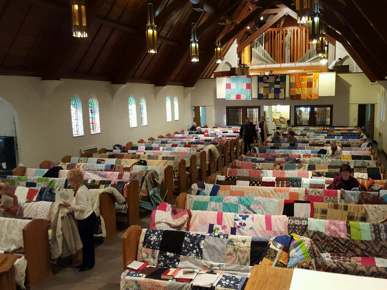 The First Lutheran Church donated 187 quilts, which could end up covering Syrian refuges or Nepali earthquake victims or Mali families fleeing food shortages and religious conflicts.