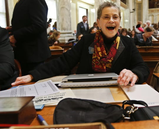 Rep. Jean Price, D-Great Falls, readies her desk on the floor of the House in Helena in 2013.