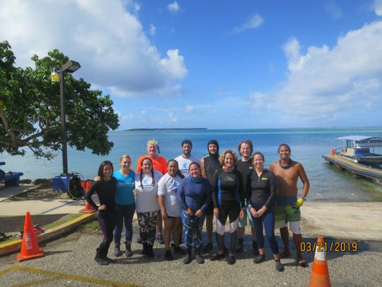 The coral transplanting team included individuals from the University of Guam Marine Lab, The Nature Conservancy, UnderWater World Guam, and the Division of Aquatic and Wildlife Resources with the Guam Department of Agriculture. Back row, from left: Brent Tibbatts; Rafael Calderón; Colin Lock; Justin Berg; Farron Taijeron. Front row, from left: Ka'ohi Kawahigashi; Coco Sartor; Sara Hamilton; Maylanie Balajadia; Mariel Cruz; Laurie Raymundo; and Claire Moreland-Ochoa.