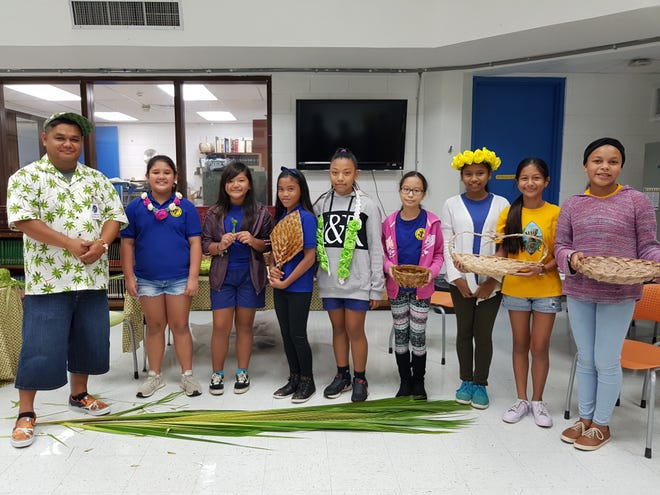 From left: Tom Torres, weaver; Abigail Balajadia; Kaylee Afaisen; LeShael Taimanglo; Ja'anah Lizama; Denise Aguon, Angilyna Thineyog; Joneva Quintanilla; and Aveyani Babauta.