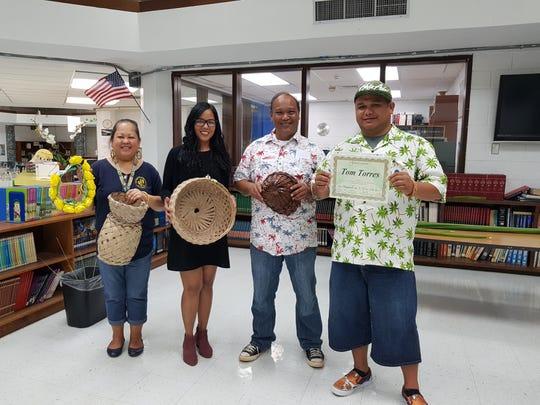 From left: Sinora LeVonne S. Mantanona; Sinora Loretta P. Cruz; Sinot Albert C. Fejeran; and Tom Torres, weaver.