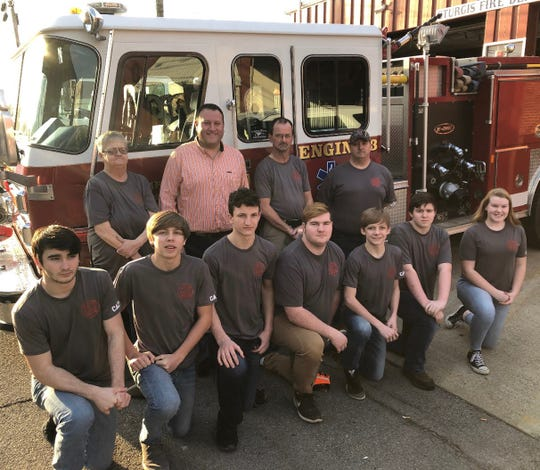 The first ever Junior Firefighter Program has started in Sturgis, KY. Front Row L to R: Quinton Cox, Riley Cullen, Tristan Moore, Johnny Fuqua II, Brock Cullen, Alex Embrey, Ashton Newcom,  Back Row: Deputy Chief Peggy Pease, Mayor Doug Rodgers, Assistant Chief Keith Wright, Firefighter/Medic Gerald Embrey.