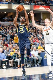Indiana Pacers forward Thaddeus Young (21) shoots past Denver Nuggets center Nikola Jokic (15) during a game between the Indiana Pacers and the Denver Nuggets at Bankers Life Fieldhouse on Sunday, March 24, 2019.