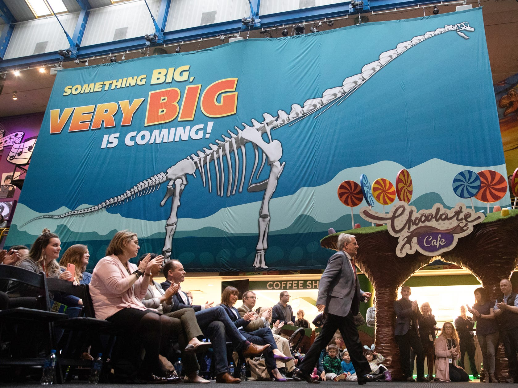 The crowd gathered applauds as Professor Richard Herrington, the acting director of science at The Natural History Museum in London, makes his way to the podium to speak about a newly discovered femur of a Brachiosaur during a press conference at the Children's Museum of Indianapolis on Monday, March 25, 2019. The Children's Museum of Indianapolis, who will serve as Mission Jurassic leader, alongside The Natural History Museum, Naturalis Biodiversity Center and the University of Manchester, will work together to excavate the fossil-rich plot of land in northern Wyoming where the femur was found.