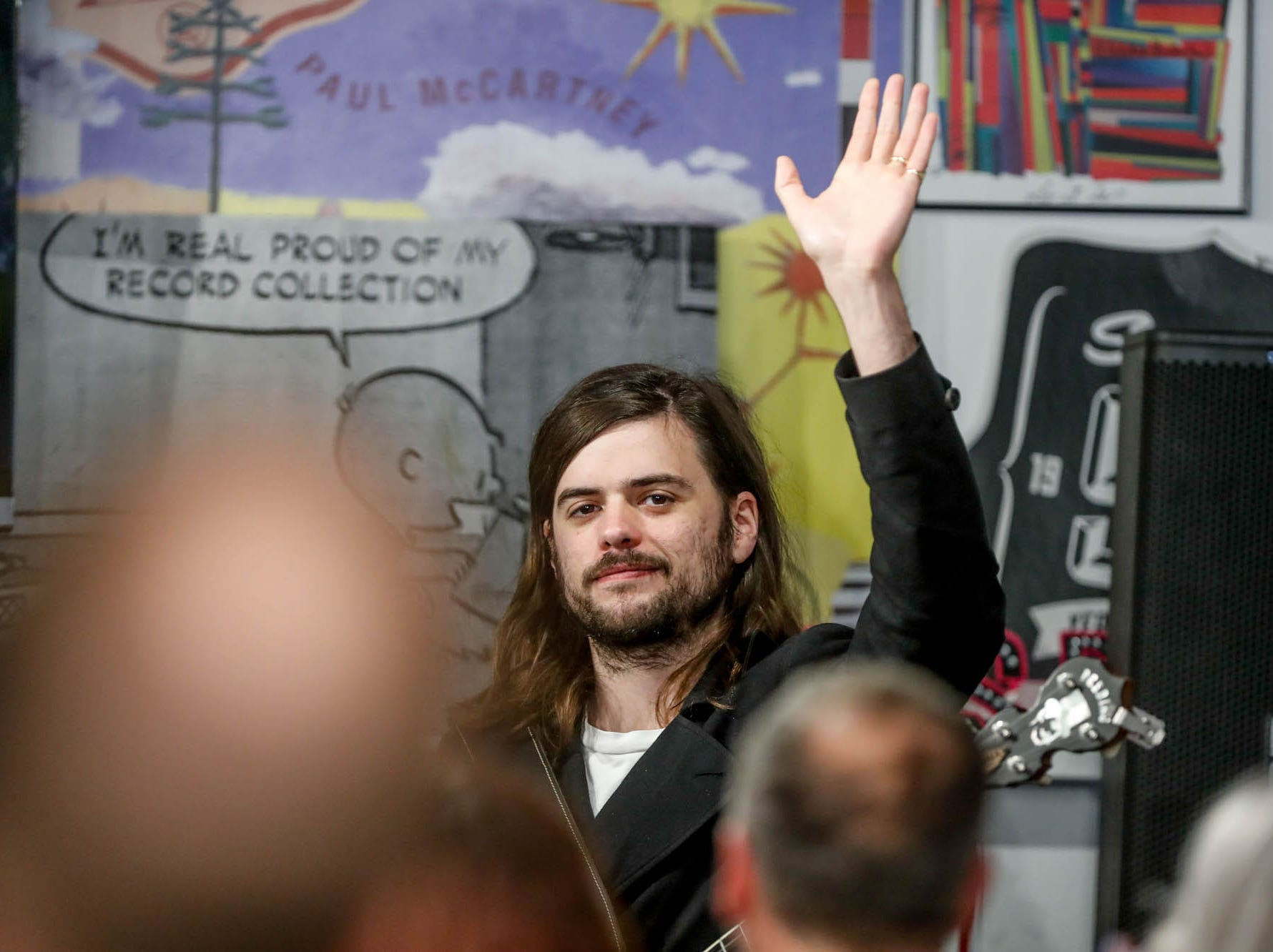 Mumford & Sons band member, Winston Marshall, waves to the fans during a special in-store appearance at Indy CD & Vinyl on Monday, March 25, 2019.