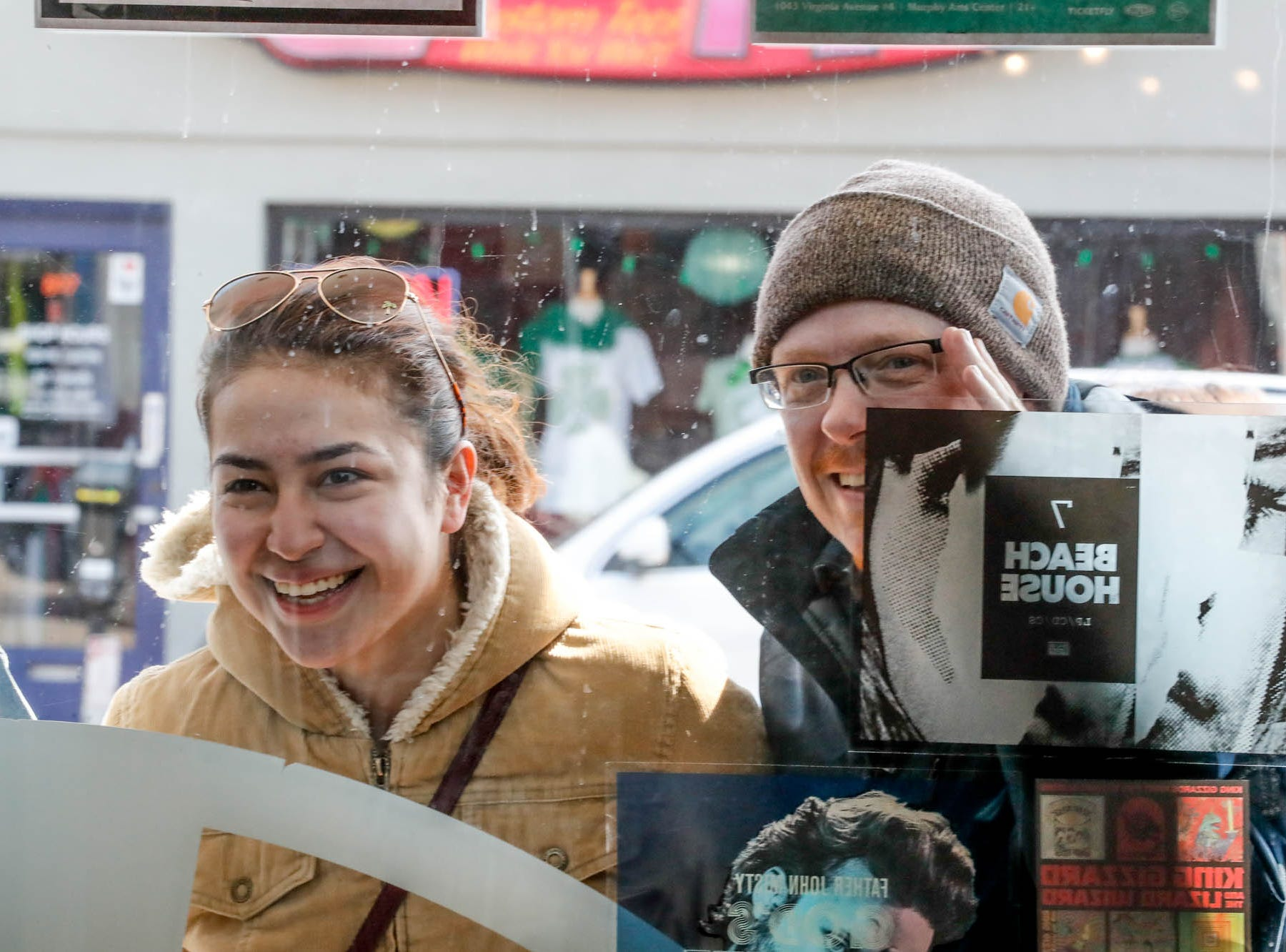Mumford & Sons fans peek through the front window during the band's special in-store appearance at Indy CD & Vinyl on Monday, March 25, 2019.