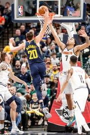 Indiana Pacers forward Doug McDermott (20) hits a dunk during a game between the Indiana Pacers and the Denver Nuggets at Bankers Life Fieldhouse on Sunday, March 24, 2019.