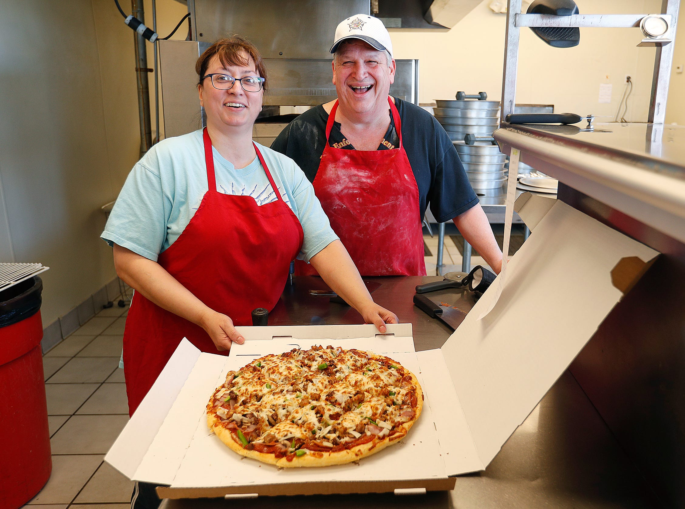 "Tom and Angie Wilhelmi moved from Chicago to Greenwood and opened AgapŽ Pizza. The ""Pizza with a Purpose"" combines their two passions of pizza and helping the homeless. 100% of the tips go to the local ministry, Tear Down the Walls. The nonprofit also receives 5% of their net sales."