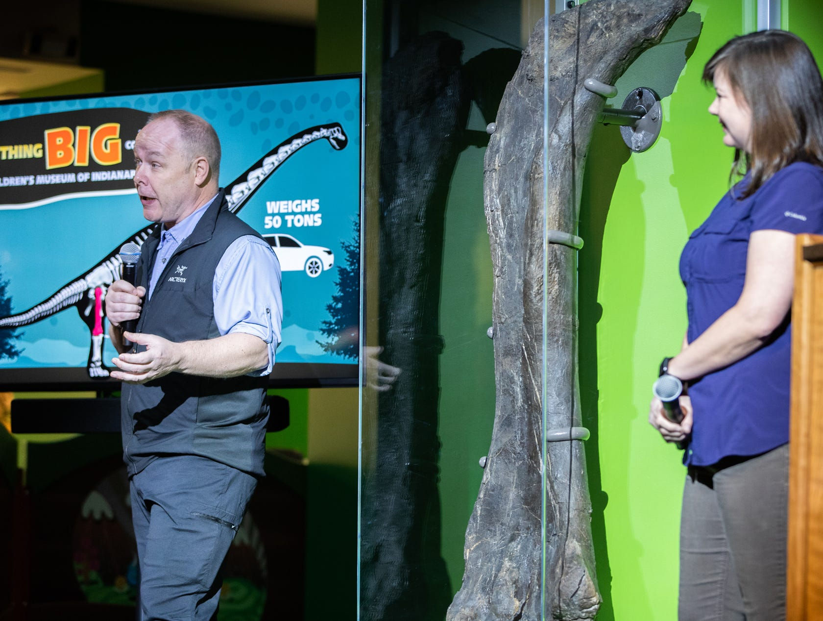 The two Children's Museum of Indianapolis' Extraordinary Scientists-in-Residence leading Mission Jurassic, Professor Phil Manning (left) and Dr. Victoria Egerton, of the University of Manchester, talk about the femur of a newly discovered  Brachiosaur at the Children's Museum of Indianapolis on Monday, March 25, 2019. The project is made possible through a lead gift from Lilly Endowment Inc.