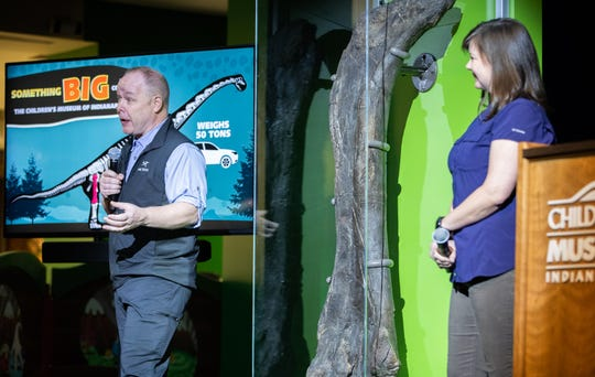 The two Children's Museum of Indianapolis' scientists-in-residence leading Mission Jurassic, Phil Manning (left) and Victoria Egerton, of the University of Manchester, talk about the femur of a newly discovered  Brachiosaur at the Children's Museum of Indianapolis on Monday, March 25, 2019. The project is made possible through a lead gift from Lilly Endowment Inc.