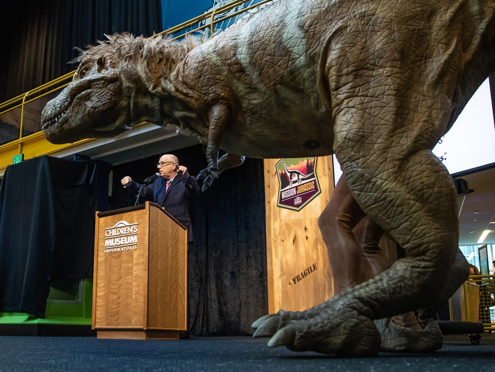 Dr. Jeff Patchen, president and CEO of The Children's Museum of Indianapolis, introduces Bucky, a Tyrannosaurus Rex puppet, during a press conference announcing Mission Jurassic at the Children's Museum of Indianapolis on Monday, March 25, 2019. The Children's Museum of Indianapolis, who will serve as Mission Jurassic leader, alongside The Natural History Museum, Naturalis Biodiversity Center and the University of Manchester, will work together to excavate the fossil-rich plot of land in northern Wyoming where the femur was found.