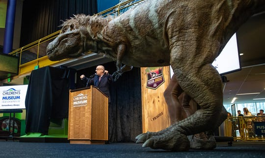 Jeff Patchen, president and CEO of The Children's Museum of Indianapolis, introduces Bucky, a Tyrannosaurus Rex puppet, at the Children's Museum of Indianapolis on March 25, 2019.