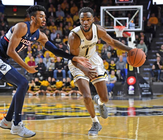Shockers forward Markis McDuffie (1) dribbles the ball against Connecticut Huskies forward Tyler Polley (12) during the first half at Charles Koch Arena.