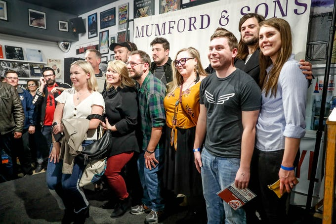 Mumford & Sons pose for photos with fans after making a special in-store appearance and mini concert at Indy CD & Vinyl on Monday, March 25, 2019.