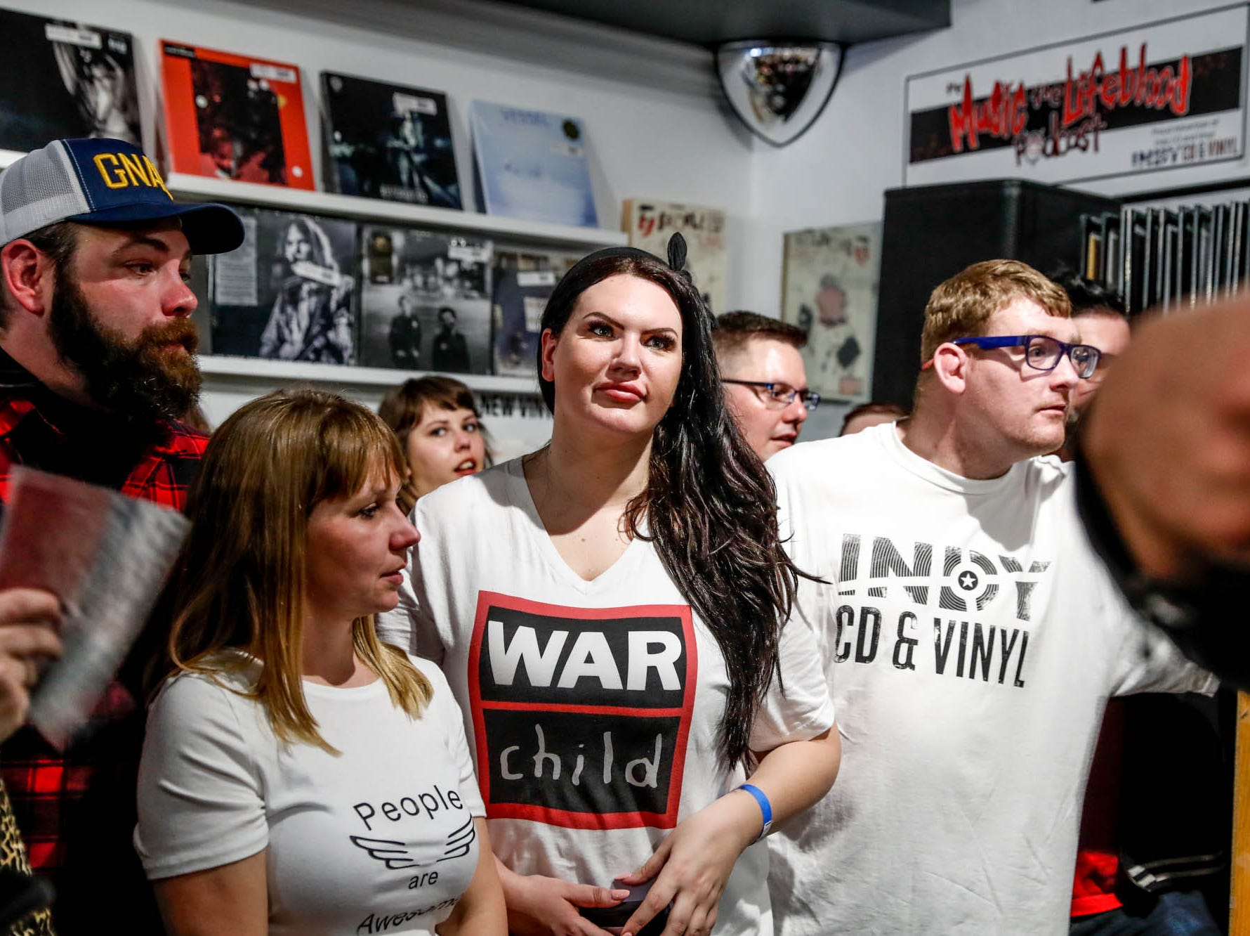 Mumford & Sons fans wait for photos with the band after a special in-store appearance at Indy CD & Vinyl on Monday, March 25, 2019.