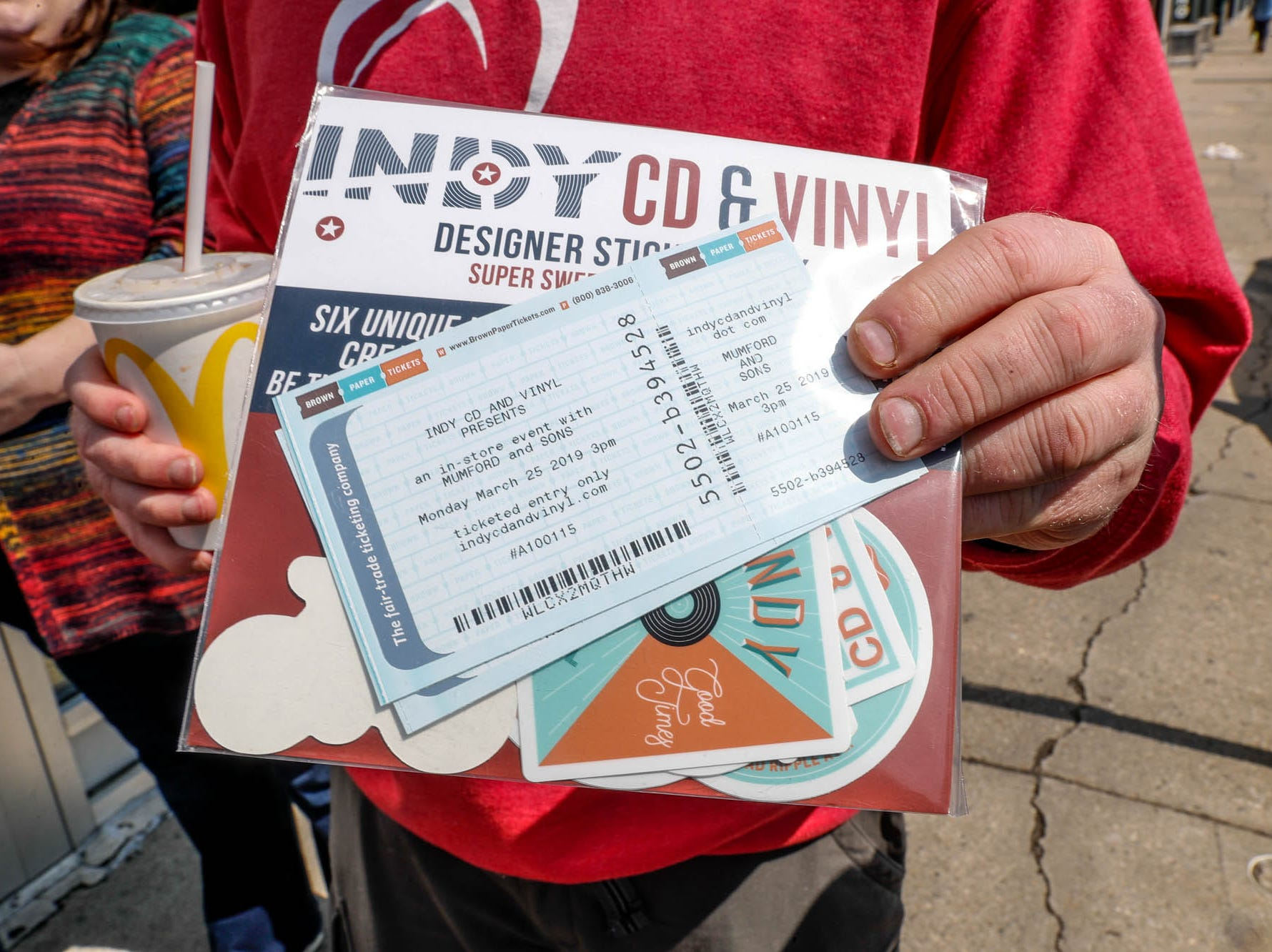 A Mumford & Sons fan shows off his tickets for a special in-store appearance at Indy CD & Vinyl on Monday, March 25, 2019.
