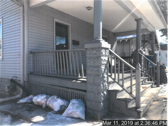 This picture of 408 N. Dubuque St. was included in the assistant housing inspector's report.