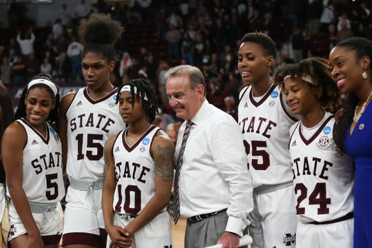 Mississippi State's Vic Schaefer celebrates with Mississippi State's Anriel Howard (5), Mississippi State's Teaira McCowan (15), Mississippi State's Jazzmun Holmes (10), Mississippi State's Zion Campbell (25), and Mississippi State's Jordan Danberry (24), all seniors. Mississippi State played Clemson in an NCAA Women's Basketball Tournament second round game on Sunday, March 24, 2019 at Humphrey Coliseum.