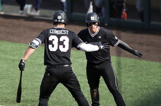 Mississippi State batters Brad Cumbest and Justin Foscue celebrate at the plate during the Bulldogs' 20-15 win over Auburn on Sunday, March 24.
