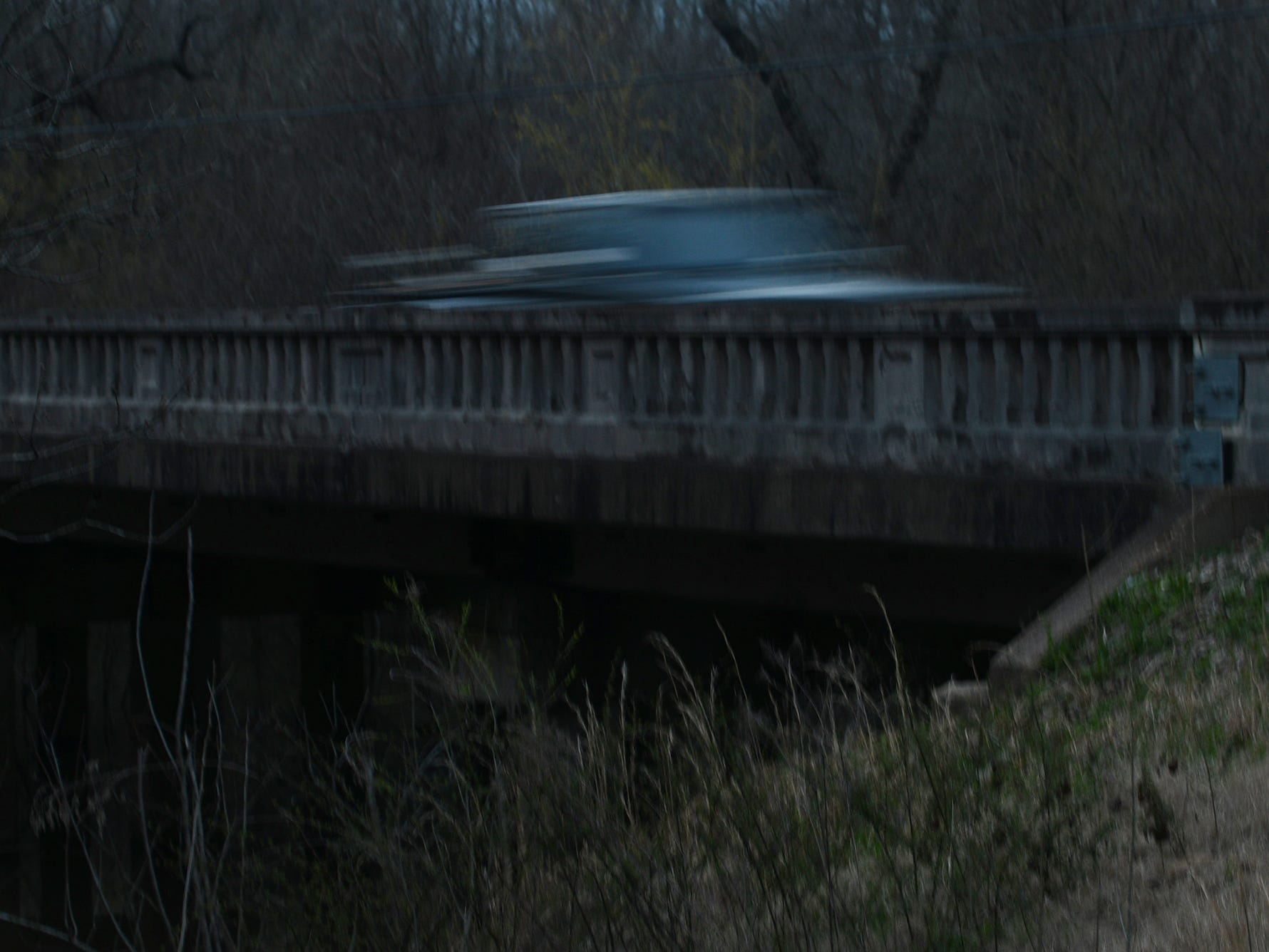 A car passes over a bridge on State Route 76 outside the Hatchie National Wildlife Preserve where Donna Perry's body was found in July 1986.