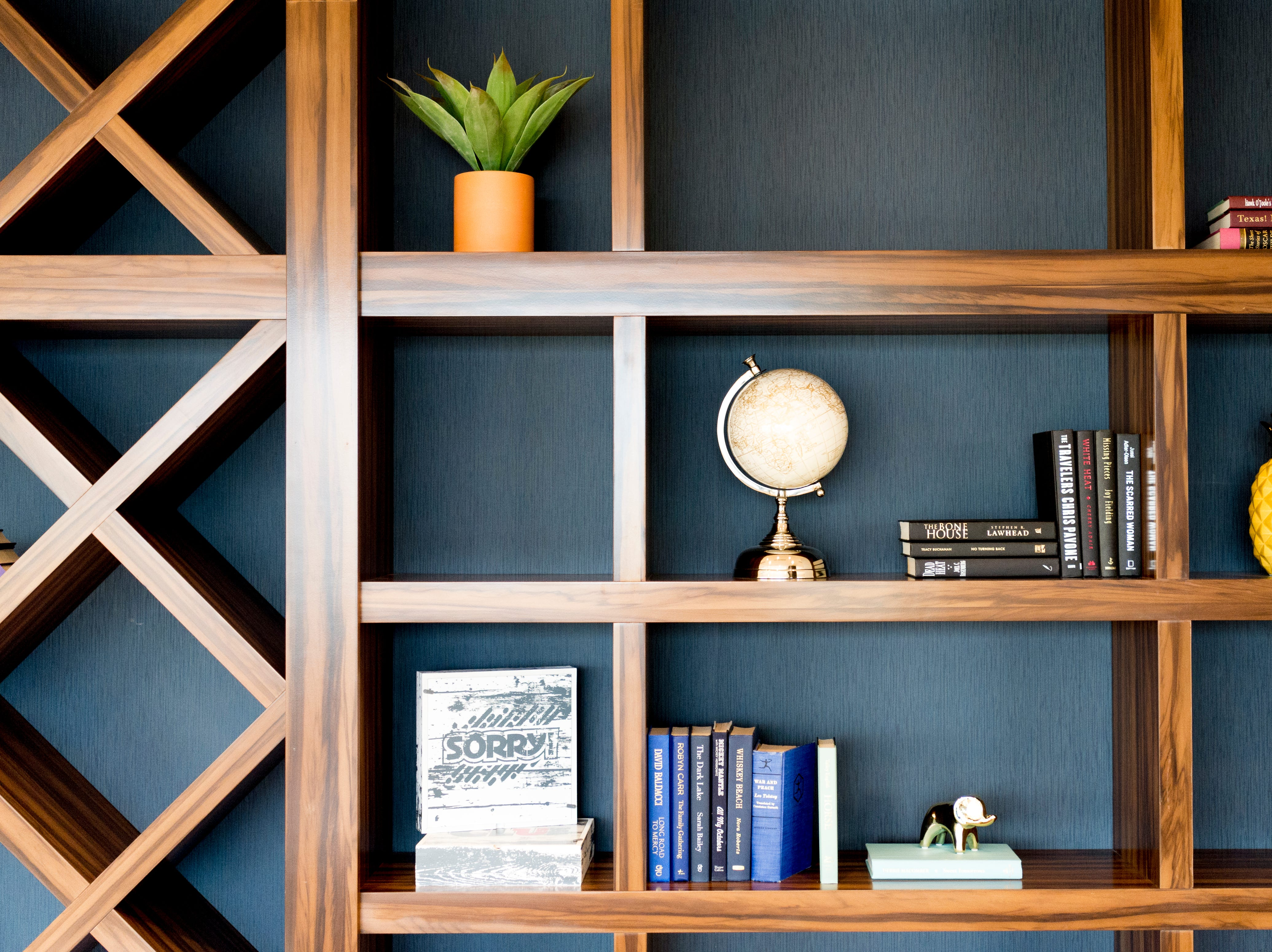 A bookshelf inside the Residence Bistro inside the new Courtyard and Residence Inn by Marriott at 210 Church Ave. in Knoxville, Tennessee on Monday, March 25, 2019. The hotel is the first of its kind in Knoxville to offer two different tiers of hospitality within the same building.