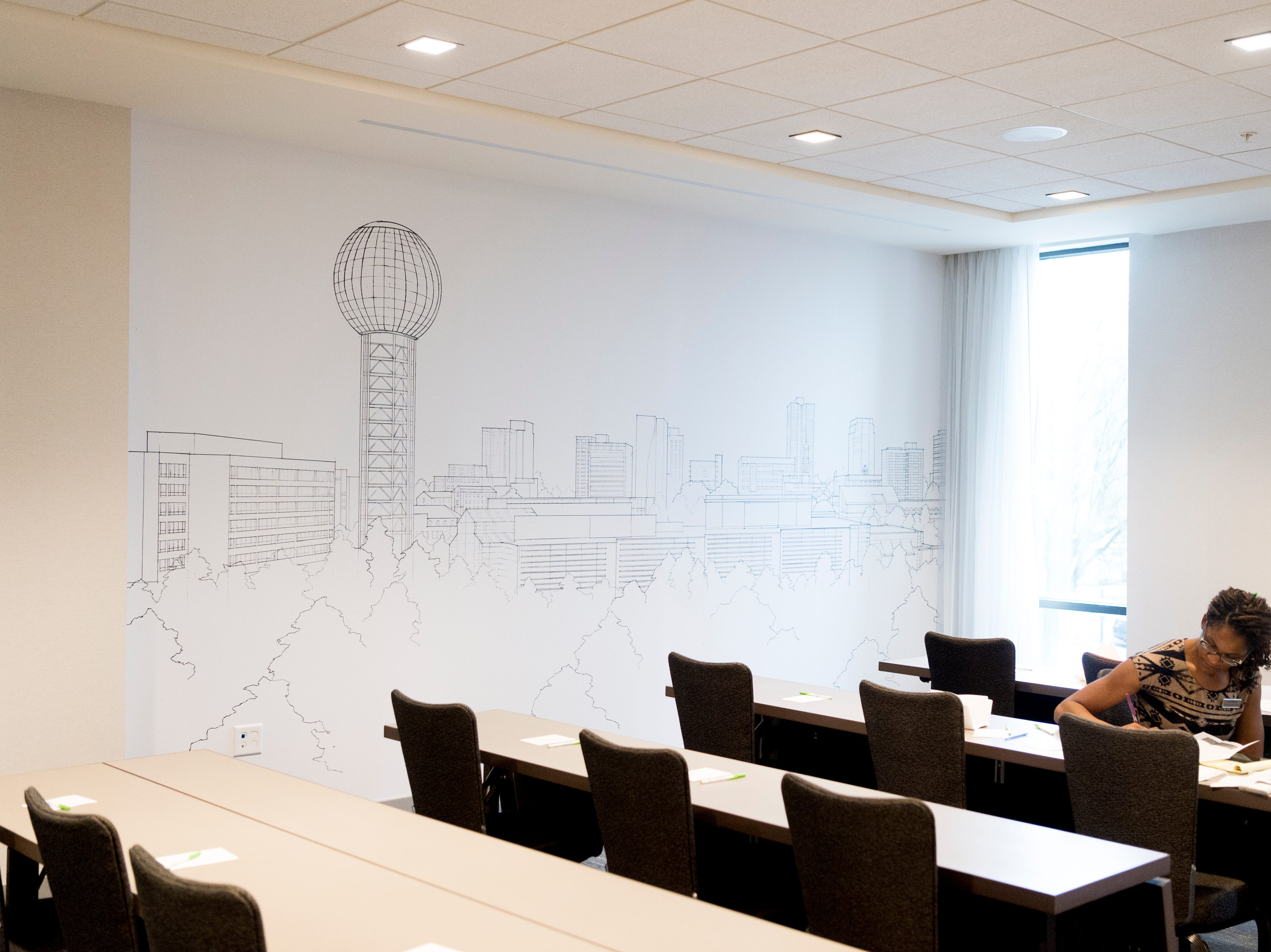 A meeting room features a sketching of the Sunsphere and the Knoxville skyline inside the new Courtyard and Residence Inn by Marriott at 210 Church Ave. in Knoxville, Tennessee on Monday, March 25, 2019. The hotel is the first of its kind in Knoxville to offer two different tiers of hospitality within the same building.