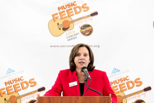 Elaine Streno, Executive Director of Second Harvest Food Bank, speaks during a Music Feeds summer concert series lineup announcement at the Tennessee Amphitheater in World's Fair Park in Knoxville, Tennessee on Monday, March 25, 2019. Proceeds from the concert series will go to benefit Second Harvest Food Bank.