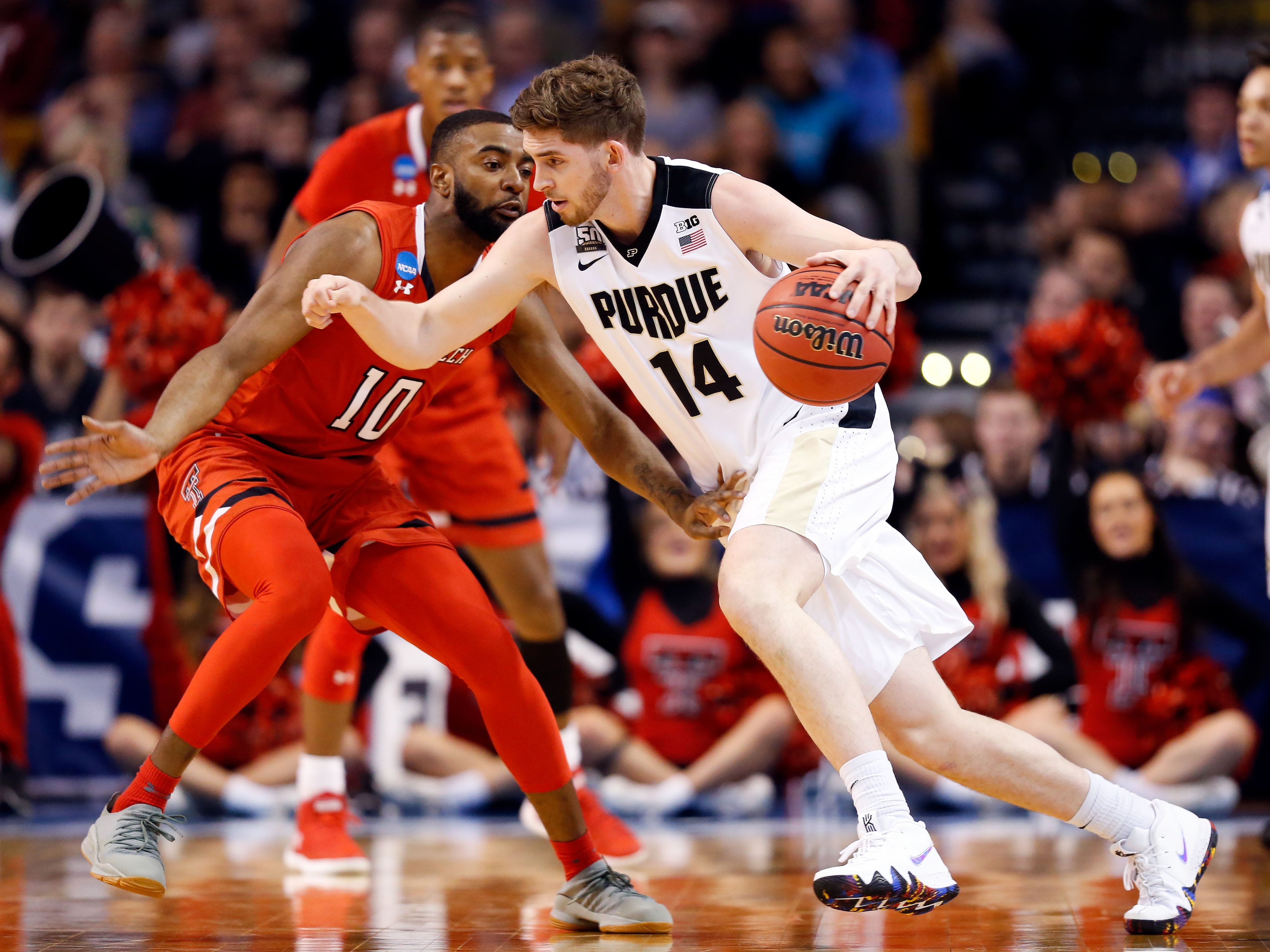 Purdue Boilermakers guard Ryan Cline (14) drives against Texas Tech Red Raiders guard Niem Stevenson (10) during the first half in the semifinals of the East regional of the 2018 NCAA Tournament at the TD Garden.