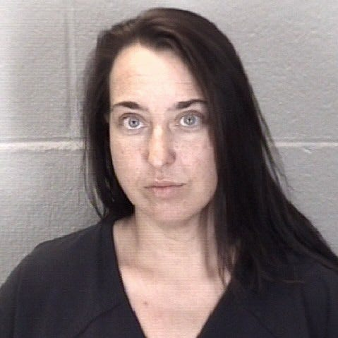 Wife accused of firing shot during domestic
