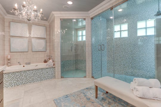 The master bath is luxurious and inviting.