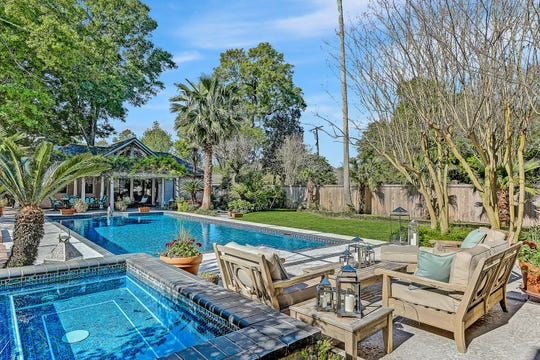 The outdoor pool area includes lots of space for entertaining.