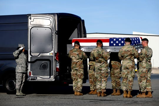 A U.S. Army carry team places a transfer case containing the remains of Spc. Joseph P. Collette into a vehicle, Sunday, March 24, 2019, at Dover Air Force Base in Delaware. According to the Department of Defense, Collette, of Lancaster, Ohio, was killed March 22 while involved in combat operations in Kunduz Province, Afghanistan.