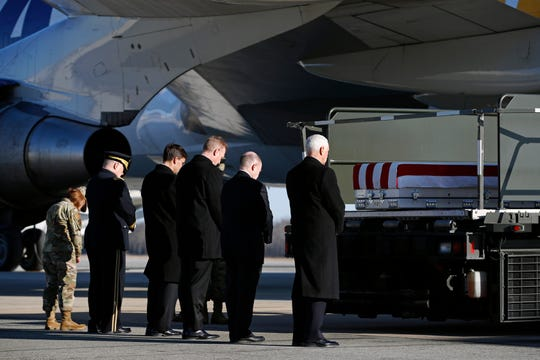 Vice President Mike Pence, right, and members of an official party pause during a prayer in front of a transfer case containing the remains of Spc. Joseph P. Collette, Sunday, March 24, 2019, at Dover Air Force Base in Delaware. According to the Department of Defense, Collette, of Lancaster, Ohio, was killed March 22 while involved in combat operations in Kunduz Province, Afghanistan.