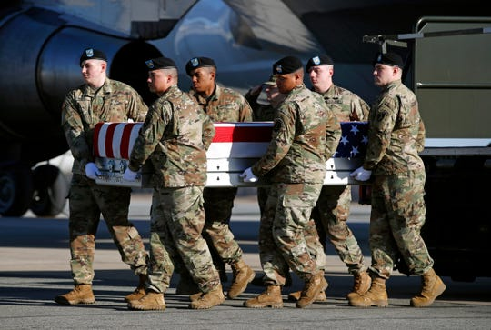 A U.S. Army carry team moves a transfer case containing the remains of Spc. Joseph P. Collette, Sunday, March 24, 2019, at Dover Air Force Base in Delaware. According to the Department of Defense, Collette, of Lancaster, Ohio, was killed March 22 while involved in combat operations in Kunduz Province, Afghanistan.