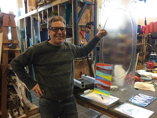 Ron Carlson shows some custom glass work from the workshop in his business Ron Carlson Glass Company, Monday, March 25, 2019. Pro Billiards is planning to move into his space after purchasing the building he and other tenants share.