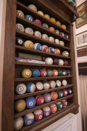 Billiard balls, cue sticks and tables are for sale at Pro Billiards in Green Oak Township, shown Monday, March 25, 2019.