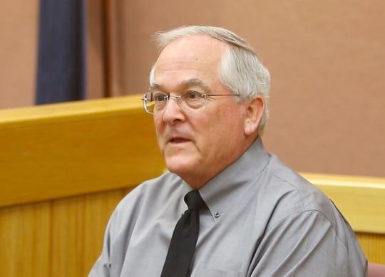Judge David Reader, shown testifying at a preliminary hearing for Judge Theresa Brennan Monday, March 25, 2019, has announced his resignation.